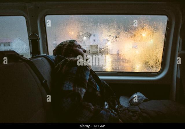 Boy sleeping car stock photos boy sleeping car stock for Sleeping with window open in winter