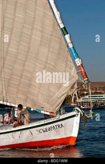 Felucca traditional wooden sailboat portrait on Nile River Aswan Egypt profile lateen sail - Stock Image