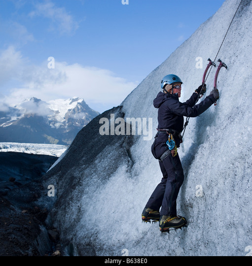 Ice Climbing on glacier, Vatnajokull Ice Cap, Eastern Iceland - Stock Image