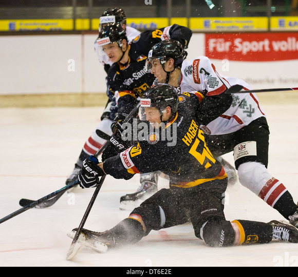 German international ice hockey player Patrick Hager, in front, plays for the German national team against Latvia. - Stock Image