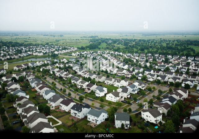 Aerial picture of rows of identical suburban homes in a subdivision in cloudy / wet weather - Stock-Bilder