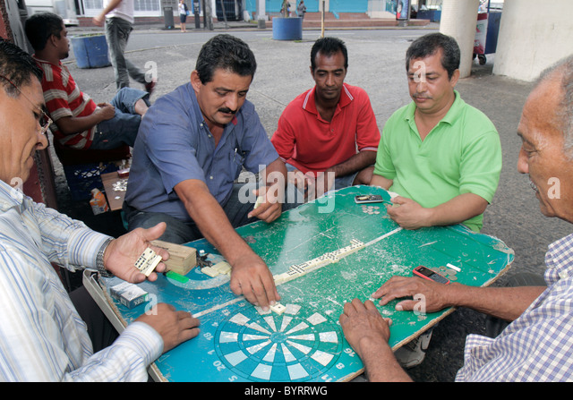 Panama City Panama Bella Vista Via Espana sidewalk barrio neighborhood hangout dominoes dominos tile game Hispanic - Stock Image