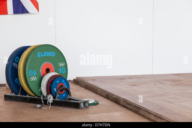 London 2012 weightlifting plates stacked in showing 10kg with Union Jack flag top left. - Stock Image