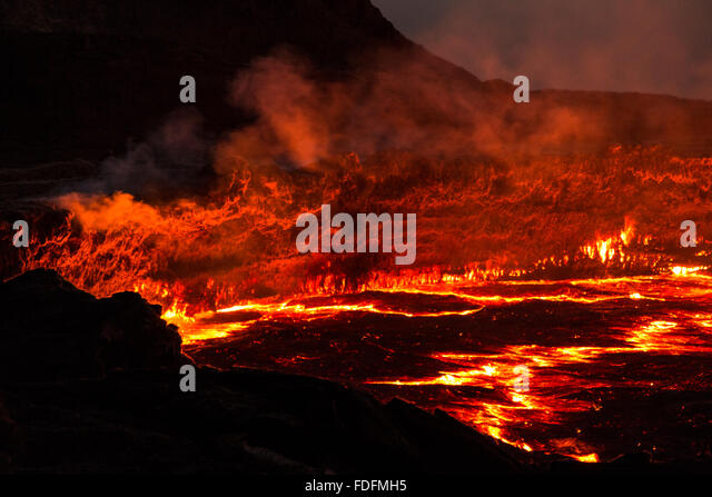 Red lines of hot lava show the cracks in the thin crust of Erta Ale's lava lake - Stock Image