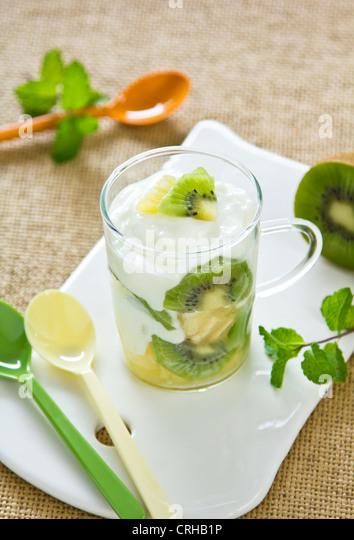 Kiwi and Pineapple with yogurt - Stock Image