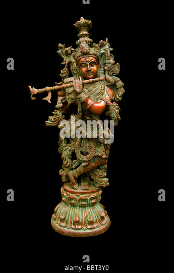 Hindu deity krishna playing flute - Stock Image