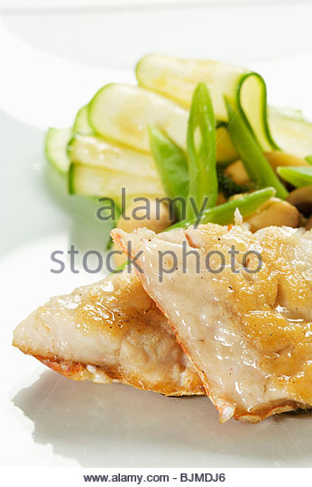 Two Fish Fillets with Vegetables - Stock Image