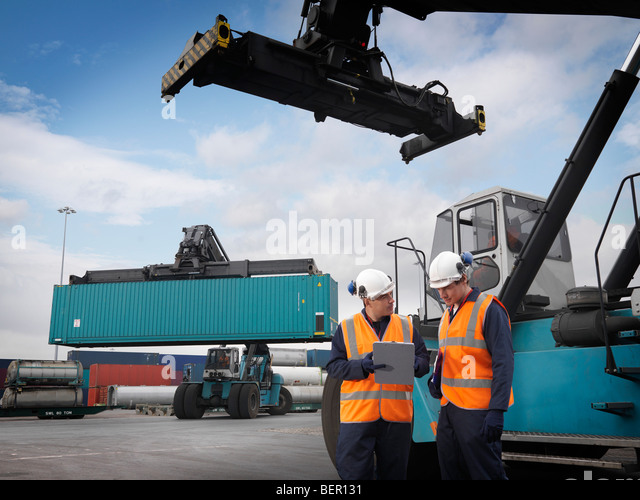 Port Worker & Shipping Containers - Stock Image