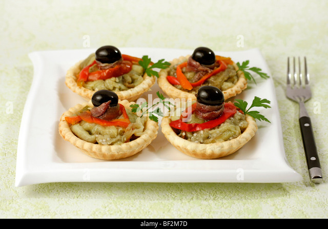 Tartlets with pepper and anchovies. Recipe available. - Stock Image