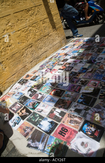 Illegal copies of music and movies for sale on a street in Cadiz, Spain - Stock Image
