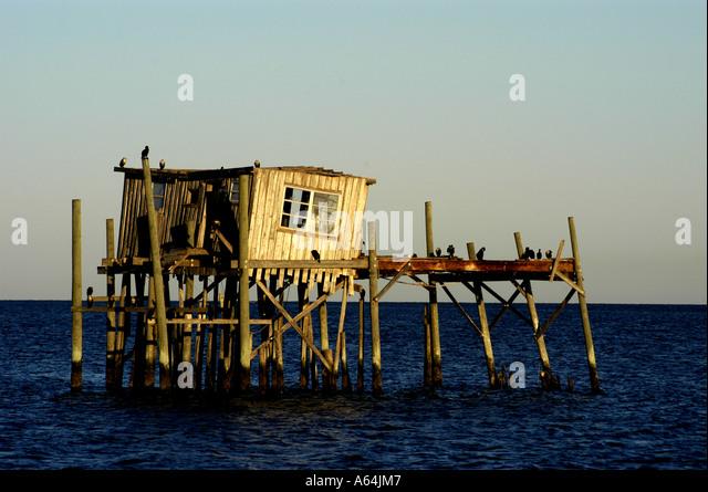 Cedar Key Florida old wood leaning stilt house famous landmark - Stock Image