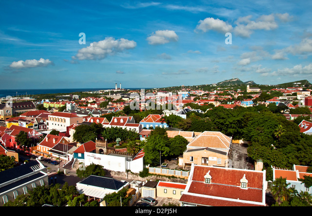 Aerial view above Otrobanda side of Willemstad, Curacao, showing colorfully painted Dutch architecture with red - Stock Image