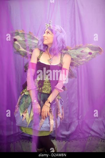 Female Fairy in her purple dream. - Stock Image
