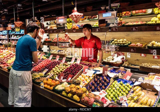 Spain Europe Spanish Hispanic Madrid Salamanca Calle de Goya Platea Madrid produce fruit sale vendor store employee - Stock Image
