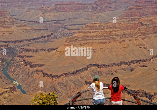 Arizona Grand Canyon National Park two women at rim overlook - Stock Image
