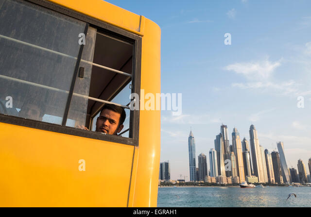 Construction worker on bus to living quarters at end of working day in Dubai United Arab Emirates - Stock-Bilder