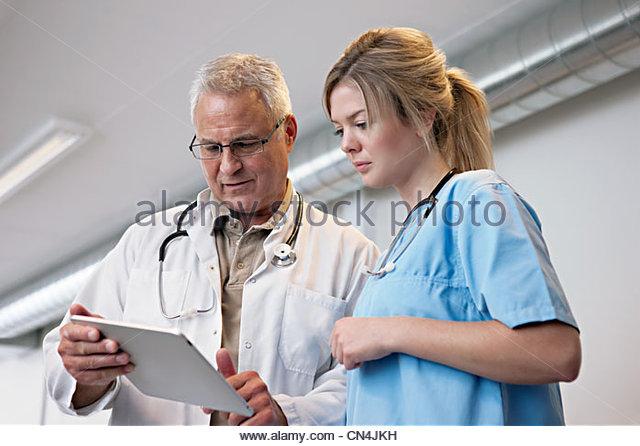 Doctors looking at digital tablet - Stock Image