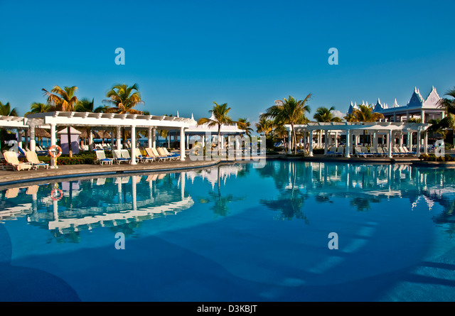 Swimming pool with bright reflections at Hotel Riu Montego Bay all-inclusive resort, no people - Stock Image
