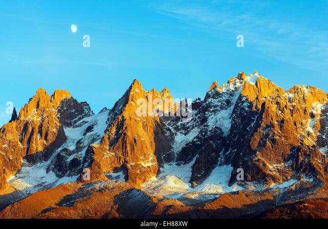 Moon rising over Aiguilles des Chamonix, Chamonix, Rhone Alps, Haute Savoie, France, Europe - Stock Image