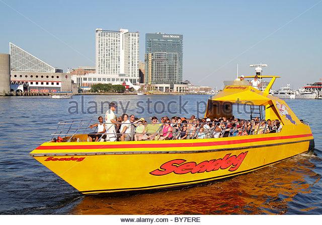 Maryland Baltimore Inner Harbor Harborplace Patapsco River waterfront aquarium skyline Seadog Speedboat Cruises - Stock Image