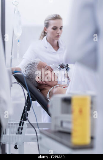 Hospital staff helping patient in emergency - Stock Image