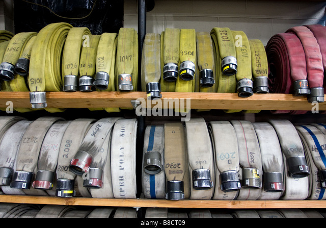 Fire hoses on storage shelf in a firehouse in West Haven Connecticut USA - Stock Image