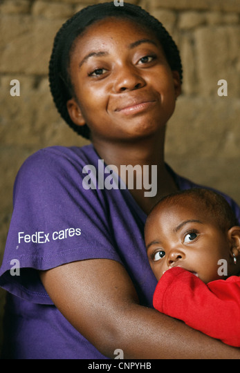 A woman holds her daughter as they wait at the Kasambondo health center in the village of Kasambondo, Katanga province, - Stock-Bilder