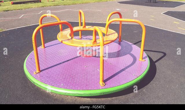 High Angle View Of Merry-Go-Round In Playground - Stock-Bilder