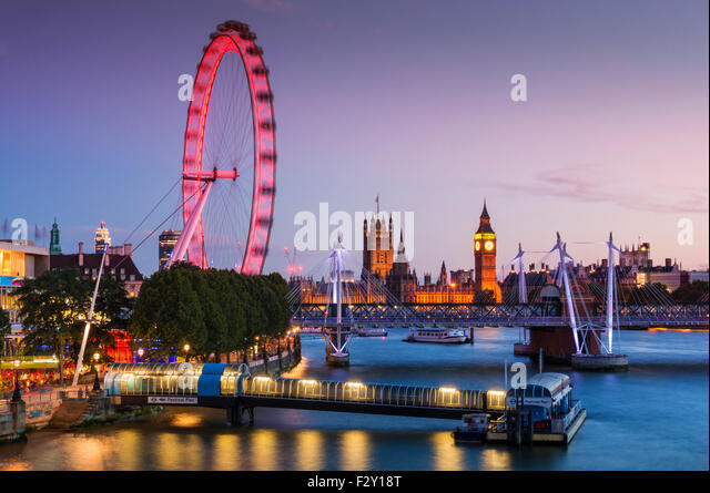London skyline with London Eye and houses of parliament on the River Thames at night London England GB UK EU Europe - Stock Image