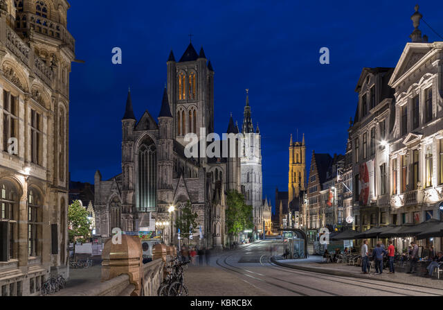 Ghent in Belgium. View from St Michael's Bridge of the 'three towers' - St Nicholas Church (Niklaaskerk), The Belfort - Stock Image