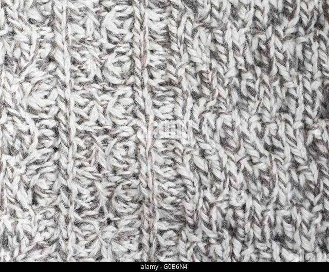 Irish sweater off-white and brown wool knitwork - Stock Image