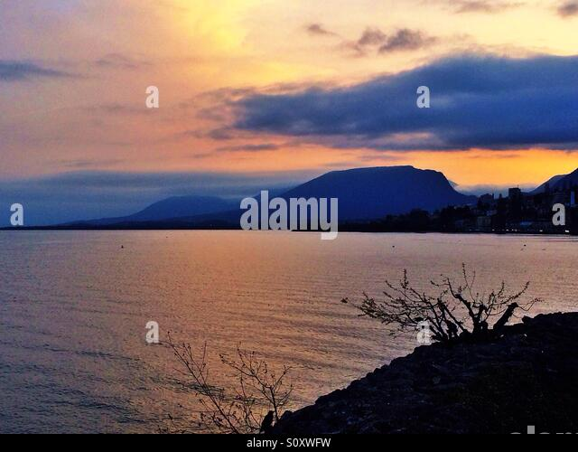 Lake and mountain view at sunset - Stock Image