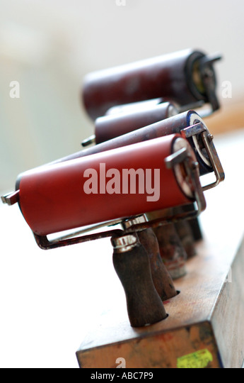 Press-on press on roll roller for lino printing printings print - Stock Image