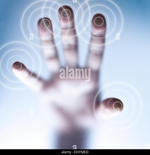 Conceptual touch screen technology with fingers touching glass - Stock Image