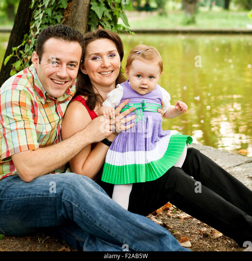 Happy joyful family - mother daughter and father - Stock Image