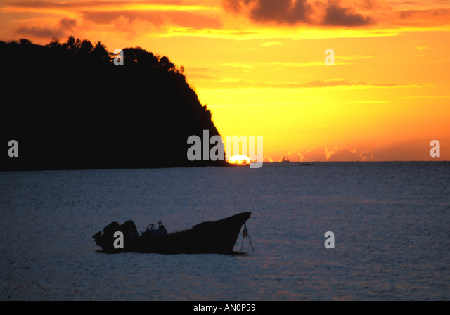 St Lucia West Indies Caribbean Fishing Boat and Island at Sunset - Stock Image