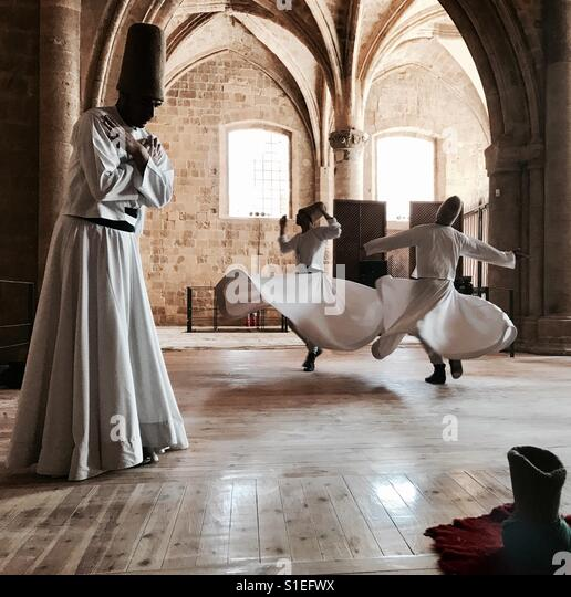 Whirling dervish in a mosque in turkey - Stock Image