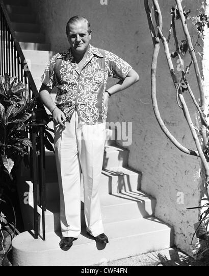 Randolph Churchill smoking a cigarette in Palm Beach, Florida, ca 1950 - Stock Image