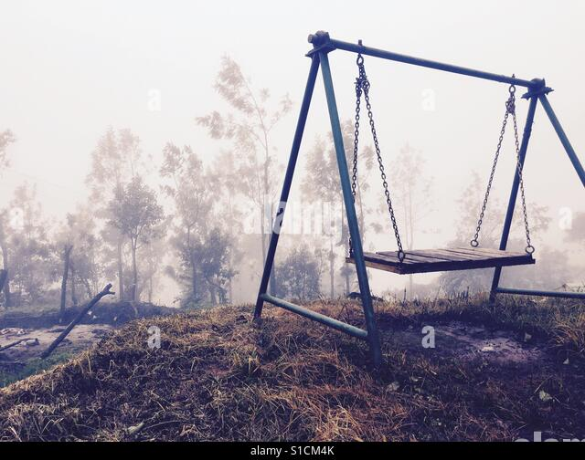 Swing at the edge of a hillock. Morning coffee never tasted better. - Stock-Bilder