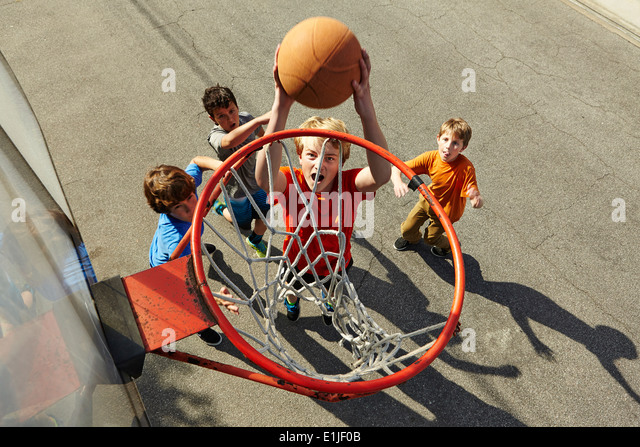 Boys playing basketball, high angle - Stock Image