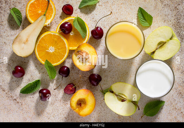 Assortment of fruits and berries for making milkshakes on the stone background. Fresh organic ingredients. Desirable - Stock Image