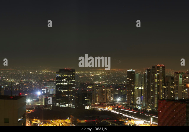 City center lit up at night - Stock Image