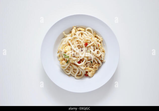 Bowl with fried Japanese Udon noodles - Stock Image
