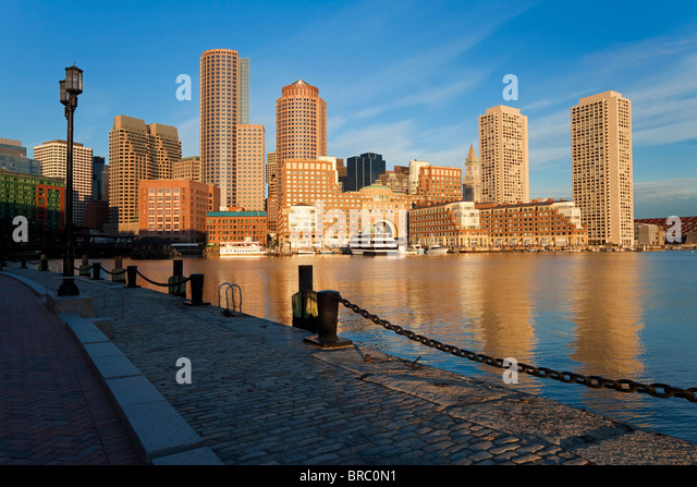 Skyline and inner harbour including Rowes Wharf at dawn, Boston, Massachusetts, New England, USA - Stock Image