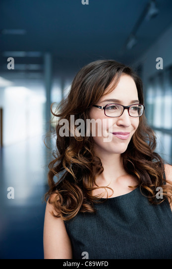 Germany, Bavaria, Diessen am Ammersee, Close up of businesswoman in thick spectacles, smiling - Stock-Bilder