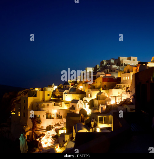beautiful night lights of Oia village, Santorini view, Greece - Stock Image