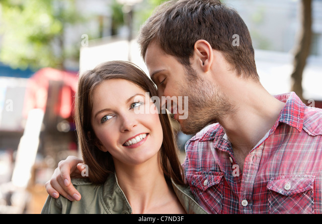 Man kissing his wife, Paris, Ile-de-France, France - Stock Image