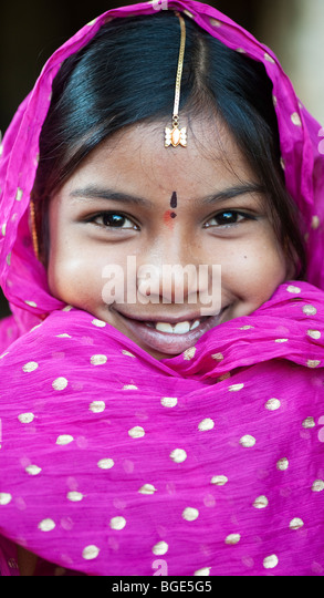 Smiling happy Indian girl wearing a black shawl - Stock Image