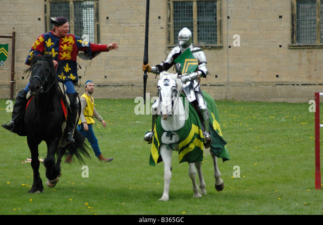 Knight handing lance to squire - Stock Image