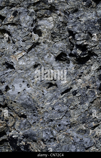 Stone texture on the mid-Cornwall coastline. - Stock Image